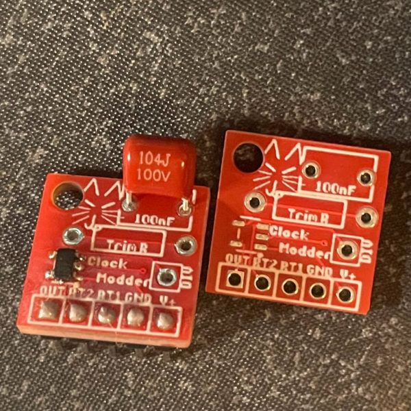 Clock Modder boards, one pre-built, the other PCB Only